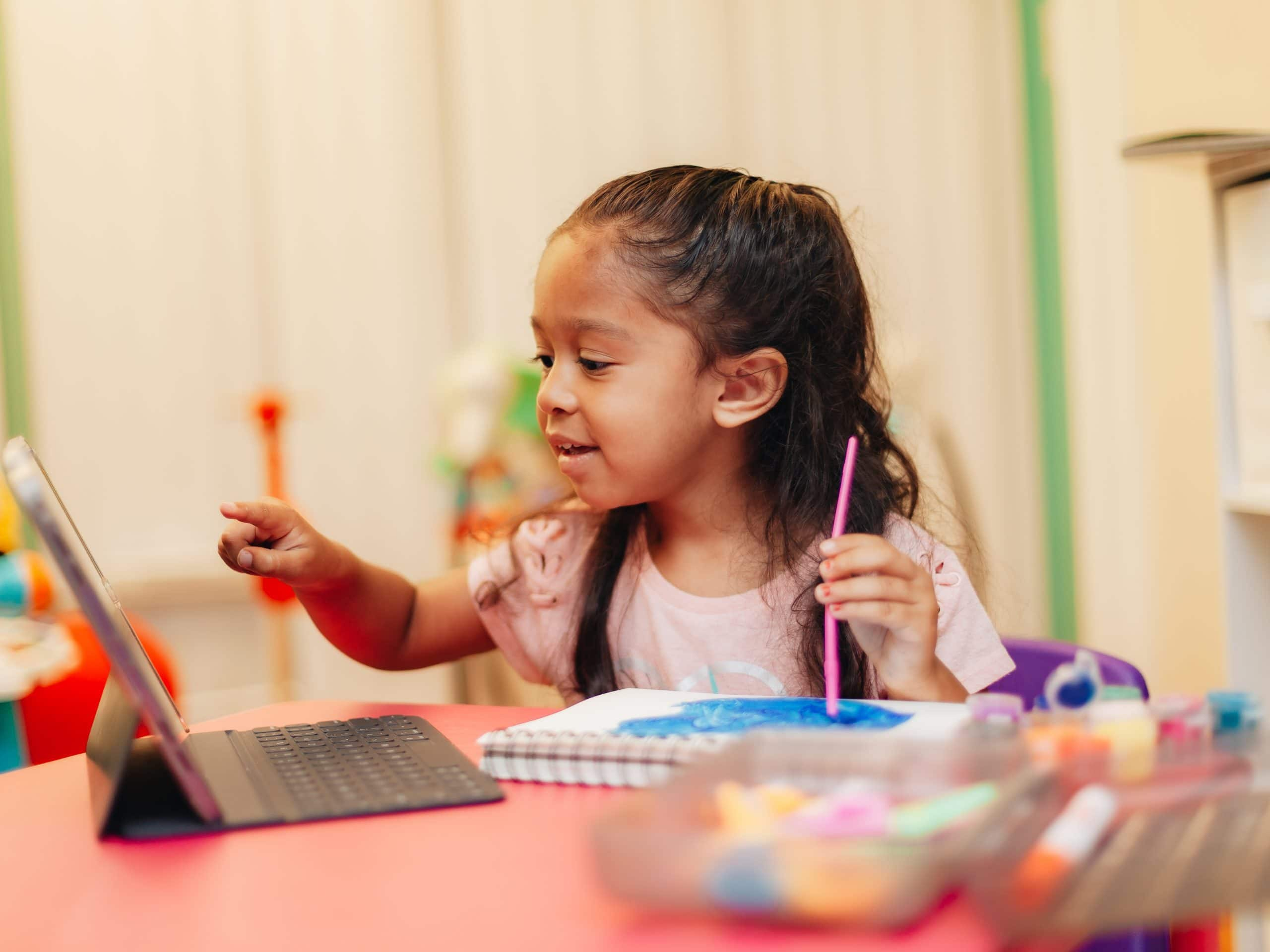 3-year-old-learning-to-paint-by-watching-video-on-laptop