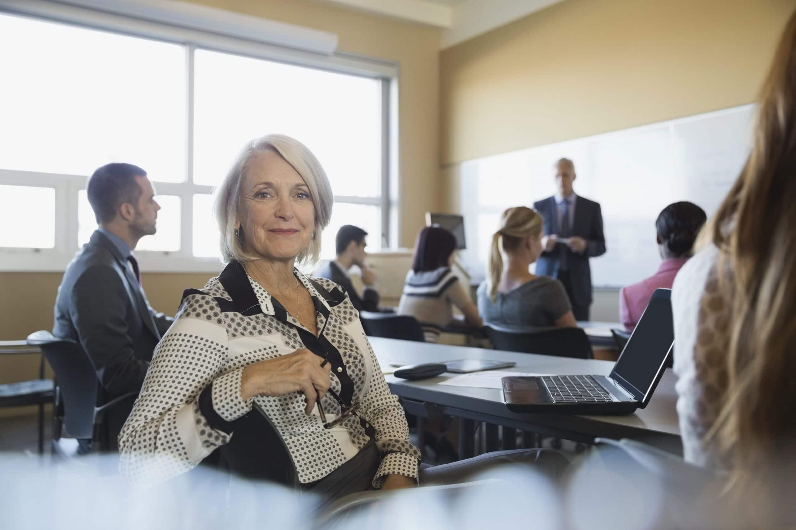 Portrait of confident businesswoman in training class