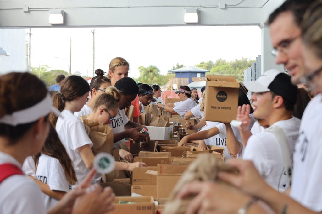 Indian River County Middle and Hish School students help to assemble over 3,000 weekend snack packs that will be distributed to local elementary school students.