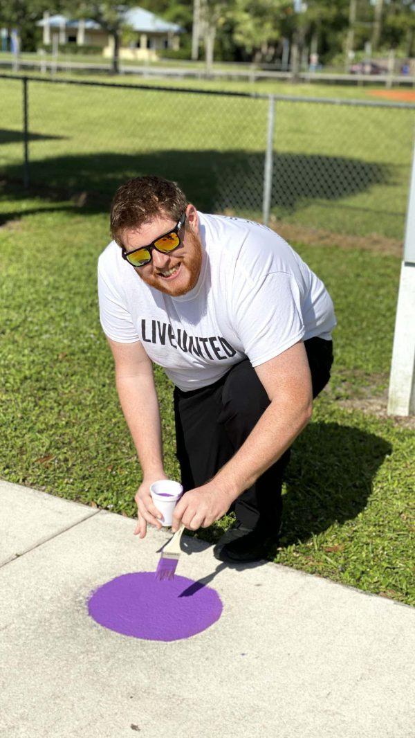 Man painting chalk art